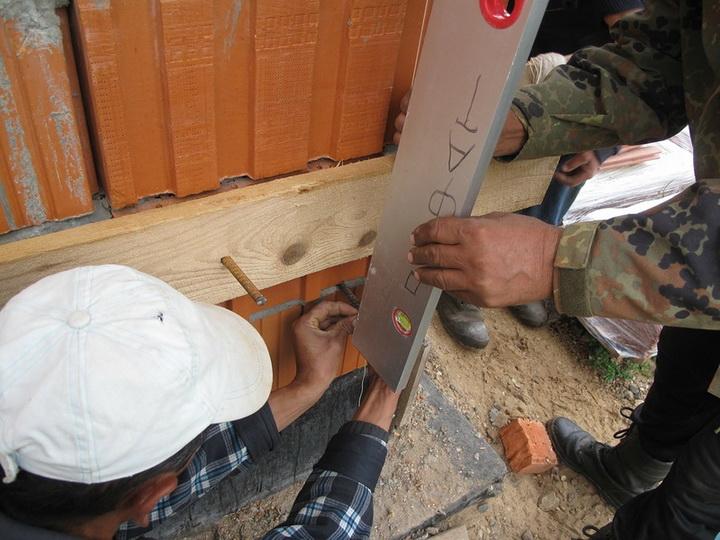 Подготовка фасада, определение плоскости утеплителя