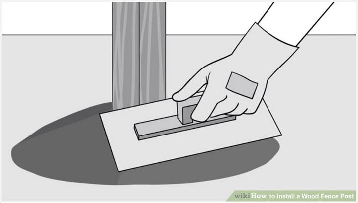 """Бетонирование деревянного столба - отвод осадков. Необходимо разгладить раствор таким образом, чтобы образовать """"горку"""" / (с) https://m.wikihow.com/Install-a-Wood-Fence-Post"""